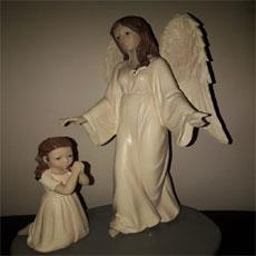 Girl Praying To Angel